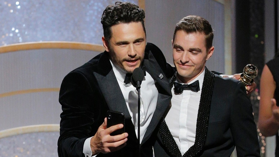 James francos golden globes win ignites outrage prompts two this image released by nbc shows james franco center embracing his brother dave franco m4hsunfo