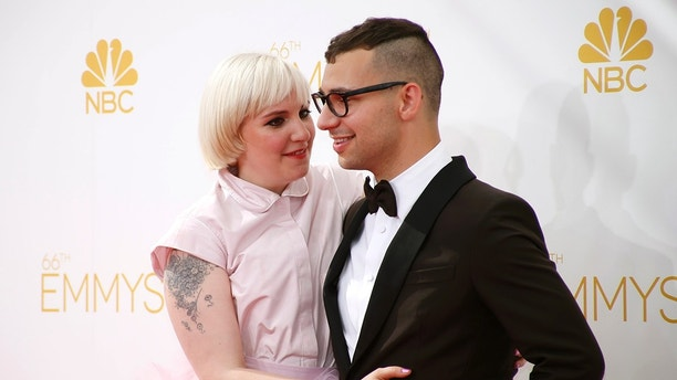 "Lena Dunham from the HBO series ""Girls"" and Jack Antonoff arrive at the 66th Primetime Emmy Awards in Los Angeles, California August 25, 2014.  REUTERS/Lucy Nicholson (UNITED STATES -Tags: ENTERTAINMENT)(EMMYS-ARRIVALS) - TB3EA8P1U9P46"