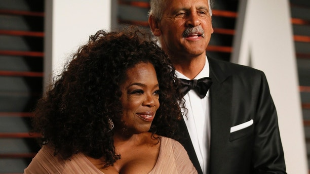 Oprah Winfrey and partner Stedman Graham arrive at the 2015 Vanity Fair Oscar Party in Beverly Hills, California February 22, 2015.