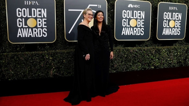 75th Golden Globe Awards – Arrivals – Beverly Hills, California, U.S., 07/01/2018 – Actress Meryl Streep (L) and the director of the National Domestic Workers Alliance, Ai-jen Poo. REUTERS/Mario Anzuoni - HP1EE171TDB6K