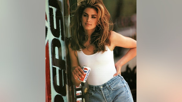 This image released by Pepsi shows actress-model Cindy Crawford in a scene from her 1992 iconic Super Bowl Pepsi commercial. Crawford returns for another Pepsi commercial which will premiere during Super Bowl LII on Feb. 4. The new ad includes her son, Presley Walker Gerber, as well as footage from Michael Jackson's memorable Pepsi commercial.