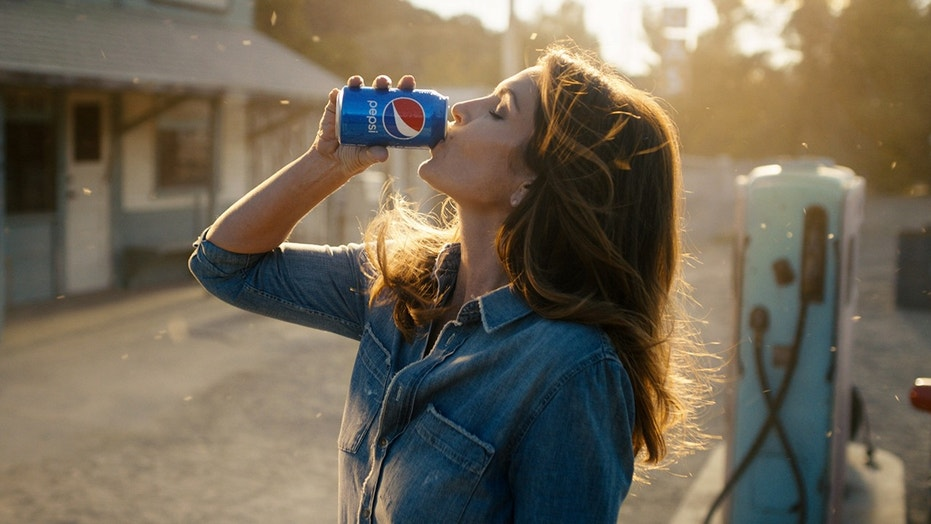 This photo released by Pepsi shows actress-model Cindy Crawford in a scene from her 2018 Pepsi commercial which will premiere during Super Bowl LII on Feb. 4. The new ad includes her son, Presley Walker Gerber, as well as footage from Michael Jackson's memorable Pepsi commercial.