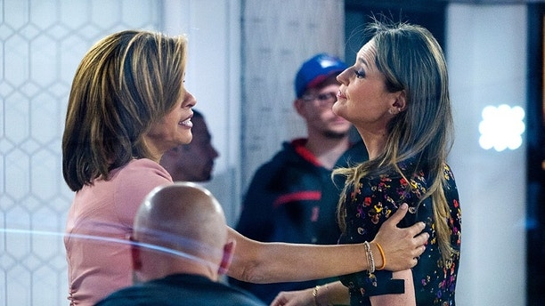 "Co-anchors Hoda Kotb, left, reaches out to Savannah Guthrie after they embraced on the set of the ""Today"" show Wednesday, Nov. 29, 2017, in New York, after NBC News fired host Matt Lauer. NBC News announced Wednesday, Nov. 29, 2017, that Lauer was fired for ""inappropriate sexual behavior.""  (AP Photo/Craig Ruttle)"