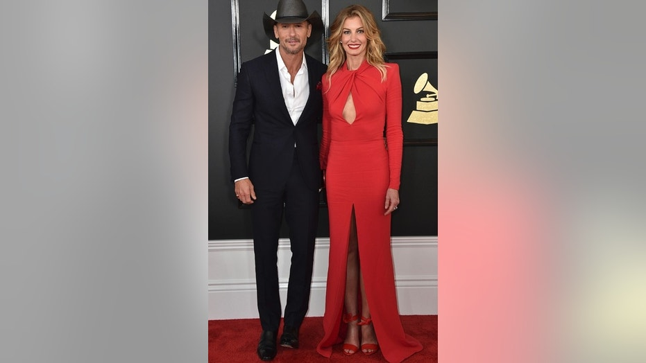 "Tim McGraw and Faith Hill are facing a copyright lawsuit for their new single ""The Rest of Our Life."" Here, the couple attend the 59th annual Grammy Awards in Los Angeles on Feb. 12, 2017."