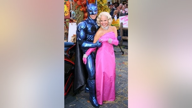 Matt Lauer (L), dressed as Batman and Katie Couric, dressed as Marilyn Monroe, co-hosts of NBC's the 'Today' show, pose during the program's annual Halloween show in New York October 31, 2005. REUTERS/Albert Ferreira - RP2DSFIFVHAA
