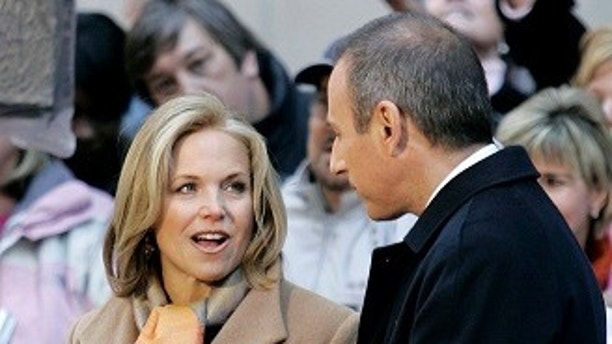 Katie Couric (L) of the NBC Today show chats with her co-host Matt Lauer outside NBC's New York City studios during the broadcast of the April 5, 2006 program. Couric, earlier in the show, told her audience that she will be leaving NBC to join the CBS Evening News where she will become the first woman to solo anchor a network evening newscast. The 49-year-old Couric has been on Today for the past 15 years. REUTERS/Mike Segar - GM1DSHYTTRAB