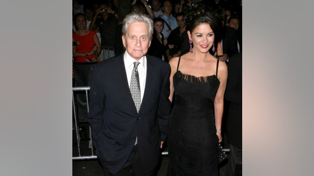 Despite his recent battle with cancer, Michael Douglas was on the red carpet with Catherine Zeta-Jones for Wall Street II, Money Never Sleeps premiere in Manhattan, on Monday. September 20, 2010 X17online.com exclusive
