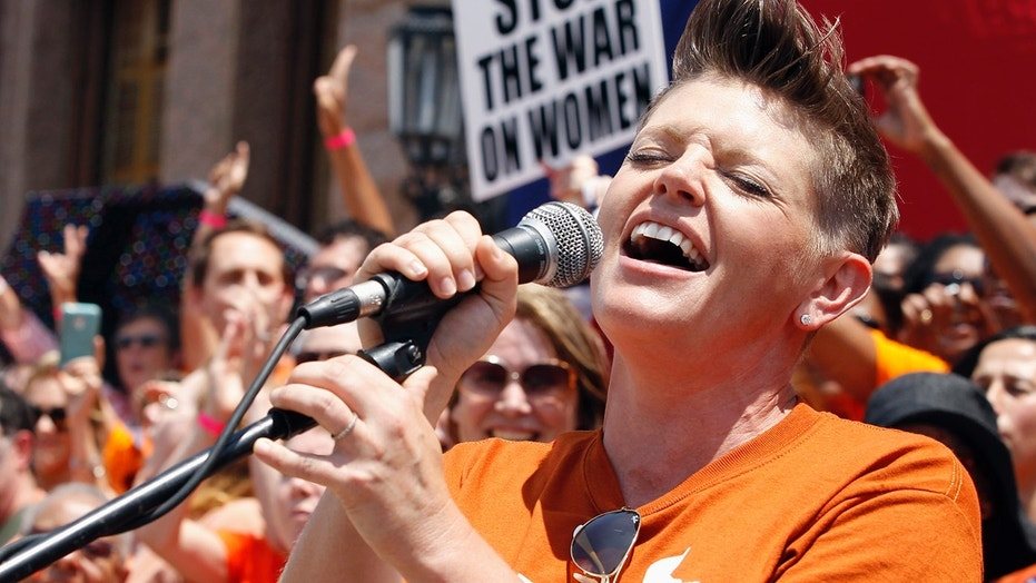 Singer Natalie Maines performs at a protest before the start of a special session of the Legislature in Austin, Texas July 1, 2013.