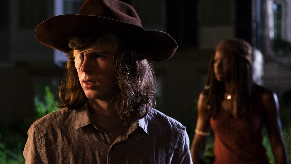 Chandler Riggs as Carl Grimes, Danai Gurira as Michonne - The Walking Dead _ Season 8, Episode 8 - Photo Credit: Gene Page/AMC