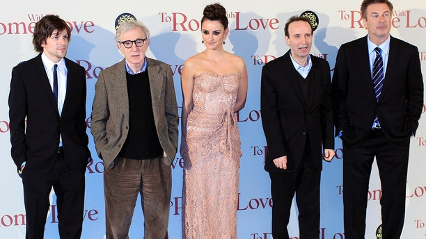 """Director Woody Allen (2nd L) and cast members, Jesse Eisenberg (L), Penelope Cruz (C), Roberto Benigni (2nd R) and Alec Baldwin, pose during the premiere of the film """"To Rome with Love"""" in Rome April 13, 2012."""