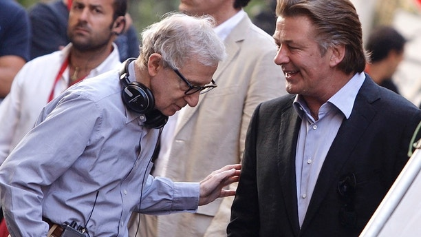 """Director Woody Allen (L) talks with Alec Baldwin during the shooting of his movie """"The Bop Decameron"""" in downtown Rome July 25, 2011."""