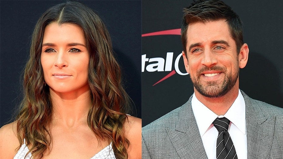 Aaron Rodgers and Danica Patrick are no longer in hiding