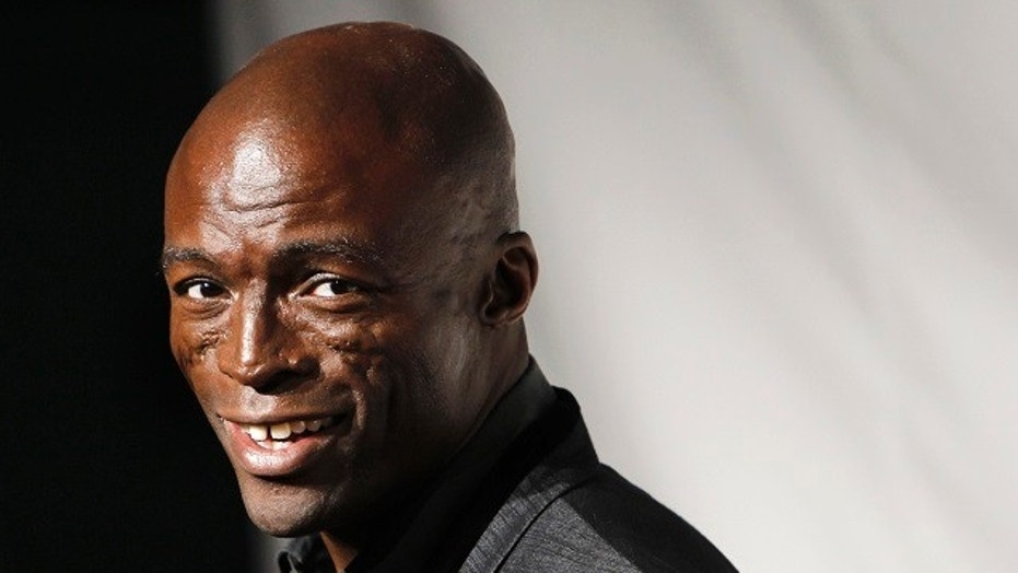 Seal has been accused by his neighbor of groping and forcibly kissing her.