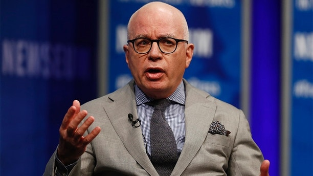 "Michael Wolff of The Hollywood Reporter speaks at the Newseum in Washington, Wednesday, April 12, 2017, as he moderates a conversation with Counselor to President Donald Trump Kellyanne Conway during ""The President and the Press: The First Amendment in the First 100 Days"" forum. (AP Photo/Carolyn Kaster)"