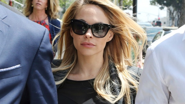 "Playboy model Danielle ""Dani"" Mathers leaves Los Angeles County Superior Court, Wednesday, May 24, 2017, after pleading no contest to charges she secretly snapped a photo of a naked 71-year-old woman in a locker room and posted it online with a mocking comment."