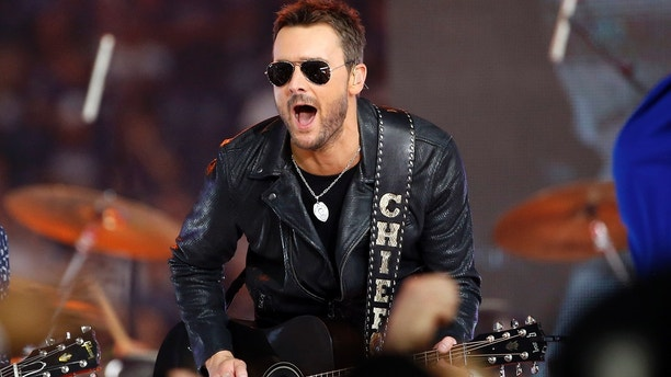 In this Nov. 24, 2016, file photo, Country music singer Eric Church performs at halftime during an NFL football game between the Washington Redskins and Dallas Cowboys in Arlington, Texas. Church, Maren Morris and Brothers Osborne, who all performed at the three-day festival prior to the mass shooting October 2017, will collaborate on a special performance at the 60th annual Grammy Awards, airing live on CBS from New York City on Jan. 28, 2018.
