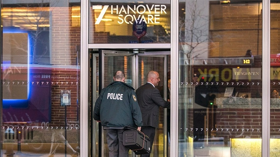 Two dozen cops and investigators storm the offices of Newsweek magazine