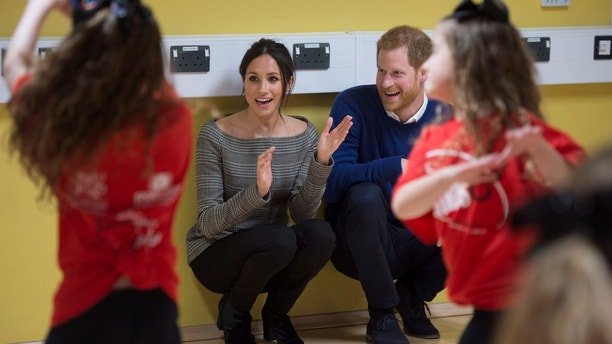 Britain's Prince Harry and his fiancee Meghan Markle attend a street dance class during their visit to Star Hub, a community and leisure centre, in Cardiff, Britain, January 18, 2018. REUTERS/Geoff Pugh/Pool - RC1C9647DFC0