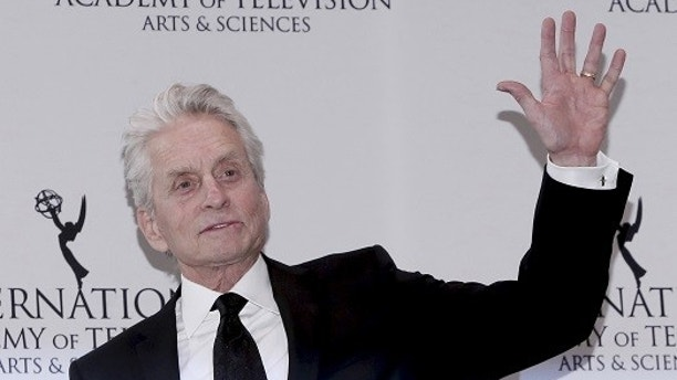 Actor Michael Douglas poses backstage during the 43rd International Emmy Awards in Manhattan, New York November 23, 2015. REUTERS/Andrew Kelly - GF20000071508