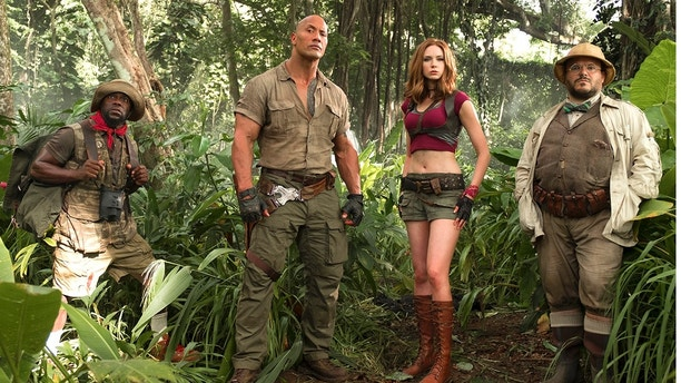 "FILE - This file image released by Sony Pictures shows Kevin Hart, from left, Dwayne Johnson, Karen Gillan and Jack Black in ""Jumanji: Welcome to the Jungle."" Columbia Pictures says Sunday, Jan. 7, 2018, that the Johnson-led ""Jumanji"" is estimated to have earned an additional $36 million, bringing its total to $244.4 million. (Frank Masi/Sony Pictures via AP, File)"