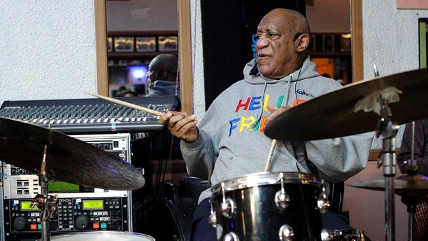 Bill Cosby plays the drums at the LaRose Jazz Club in Philadelphia on Monday, Jan. 22, 2018. It was his first public performance since his last tour ended amid protests in May 2015. Cosby has denied allegations from about 60 women that he drugged and molested them over five decades. He faces an April retrial in the only case to lead to criminal charges. (AP Photo/Michael R. Sisak)