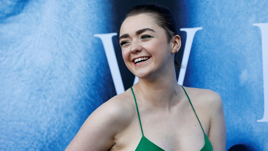 Cast member Maisie Williams poses at a premiere for season 7 of the television series