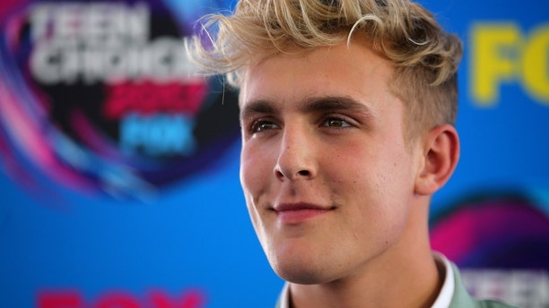 FILE PHOTO: Actor Jake Paul arrives at the 2017 Teen Choice Awards in Los Angeles, California, U.S., August 13, 2017.    REUTERS/Mike Blake/File Photo - RC1BB7F4C8E0