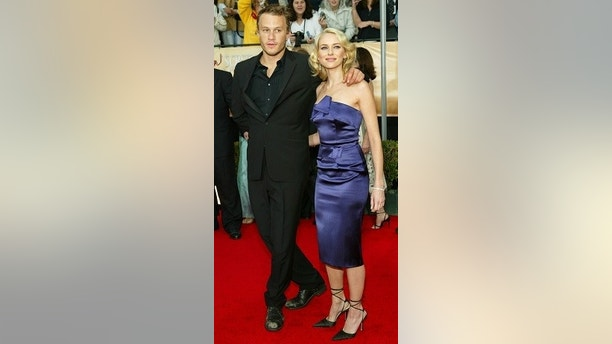 Nominee Naomi Watts from Australia and boyfriend, actor Heath Ledger arrive for the 10th annual Screen Actors Guild Awards at the Shrine Auditorium in Los Angeles February 22, 2004. Watts and Ledger are from Australia. REUTERS/Lucy Nicholson  GMH - RP4DRIHIVYAA