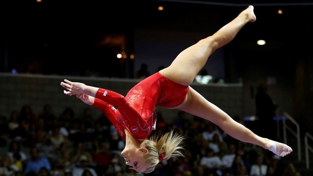 U.S. gymnast Nastia Liukin performs on the balance beam at the U.S. Olympic gymnastics trials in San Jose, California July 1, 2012.  REUTERS/Mike Blake  (UNITED STATES - Tags: SPORT GYMNASTICS OLYMPICS) - GM1E8720ZPU01