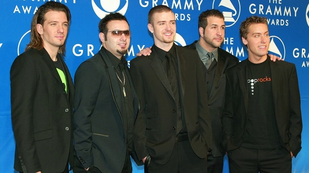 The pop group N'Sync stop to pose for photographers as they arrive for
