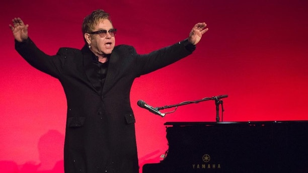"Elton John performs at the Elton John AIDS Foundation's 13th Annual ""An Enduring Vision"" benefit at Cipriani's Wall Street on Tuesday, Oct. 28, 2014, in New York. (Photo by Charles Sykes/Invision/AP)"