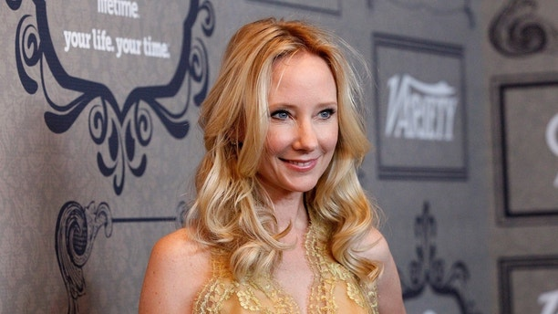 Actress Anne Heche poses at Variety's 4th Annual Power of Women event in Beverly Hills, California October 5, 2012.   REUTERS/Mario Anzuoni (UNITED STATES - Tags: ENTERTAINMENT) - GM1E8A60JQ801