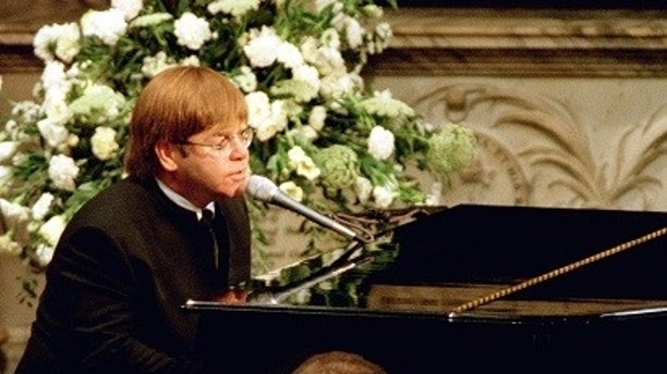 Pop-star Elton John sings a rewritten version of his song 'Candle in the wind' as a tribute to Diana, Princess of Wales at her funeral, September 6.  Over a million mourners lined the route of the funeral procession through London. - PBEAHUMOXAT