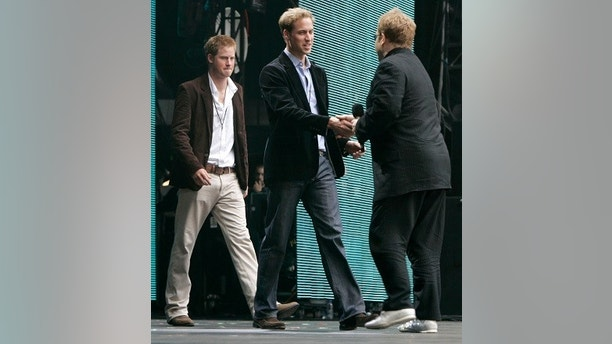 Princes Harry (L) and William (C) greet Elton John at the start of the Concert for Diana at Wembley Stadium in London July 1, 2007. Princess Diana's sons staged a charity concert in her memory on Sunday which they hope will quell her critics and celebrate her humanitarian achievements.   REUTERS/Luke MacGregor    (BRITAIN) - GM1DVPLFLZAA