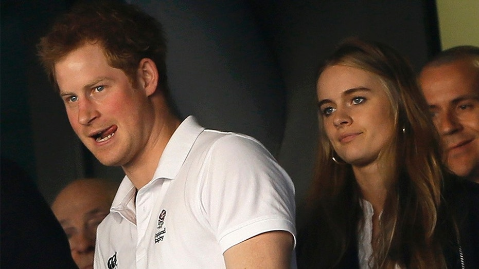 Britain's Prince Harry and Cressida Bonas attend England's Six Nations international rugby union match against Wales at Twickenham in London March 9, 2014. REUTERS/Stefan Wermuth (BRITAIN - Tags: SPORT RUGBY ROYALS) - GM1EA3A04PZ01