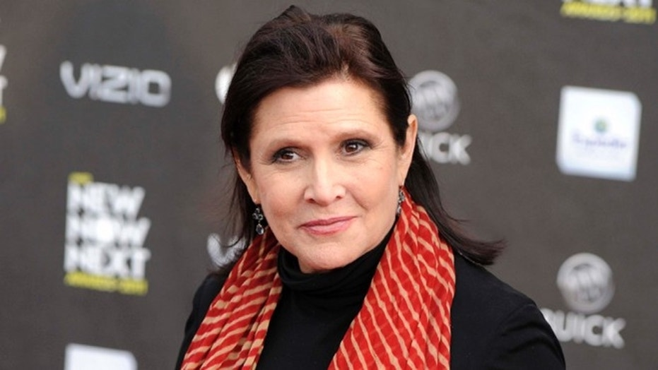 "FILE - This April 7, 2011 file photo shows Carrie Fisher at the 2011 NewNowNext Awards in Los Angeles. Lucasfilm, the company behind ""Star Wars,"" says there are no plans to digitally recreate the late Carrie Fisher to play Princess Leia in future episodes of the movie saga. The Disney-owned Lucasfilm made the rare foray into the world of ""Star Wars"" speculation Friday, Jan. 13, 2017 by issuing the statement denying any plans to digitize Fisher, who died Dec. 27. (AP Photo/Chris Pizzello, File)"
