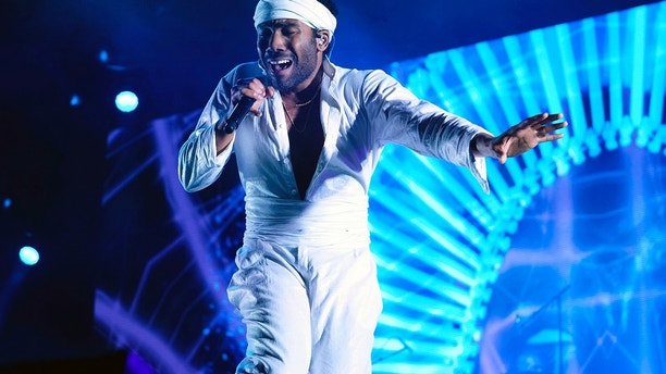 FILE - In this June 3, 2017, file photo, Donald Glover, who goes by the stage name Childish Gambino, performs at the Governors Ball Music Festival in New York. Childish Gambino was nominated for five Grammy nominations on Tuesday, Nov. 28.
