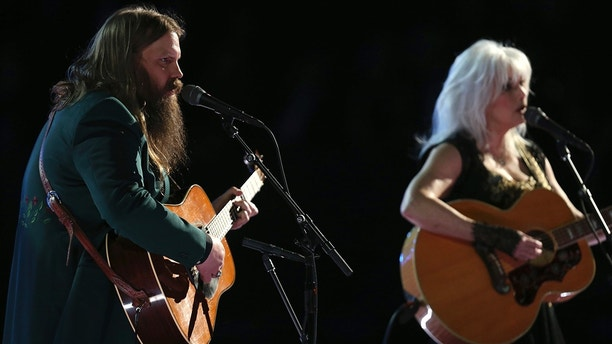"Chris Stapleton and Emmylou Harris perform ""Wildflowers"" during an In Memoriam tribute to Tom Petty at the 60th annual Grammy Awards at Madison Square Garden on Sunday, Jan. 28, 2018, in New York."