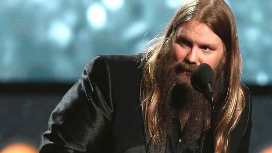 "Chris Stapleton accepts the award for best country album for ""From A Room: Volume 1"" at the 60th annual Grammy Awards at Madison Square Garden on Sunday, Jan. 28, 2018, in New York."