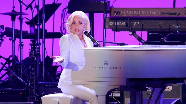 Lady Gaga performs for the five former U.S. presidents, Jimmy Carter, George H.W. Bush, Bill Clinton, George W. Bush, and Barack Obama during a concert at Texas A&M University benefiting hurricane relief efforts in College Station, Texas, U.S., October 21, 2017. REUTERS/Richard Carson - RC1F75AC9F30