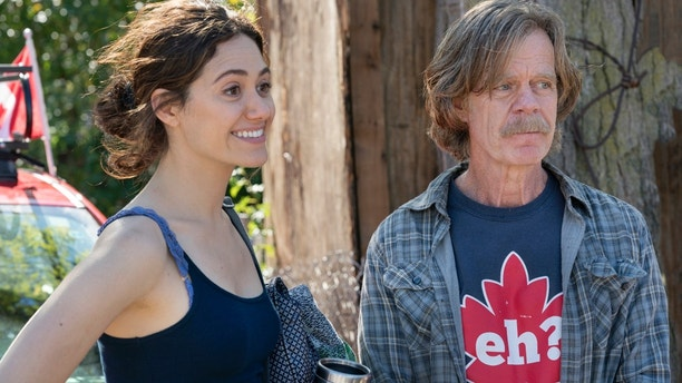 "Emmy Rossum as Fiona Gallagher and William H. Macy as Frank Gallagher in ""Shameless."""