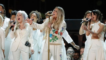 "60th Annual Grammy Awards – Show – New York, U.S., 28/01/2018 – Kesha (2nd from R) performs ""Praying"" with Bebe Rexha (L), Cyndi Lauper and Camila Cabello (R). REUTERS/Lucas Jackson - HP1EE1T07X3EZ"