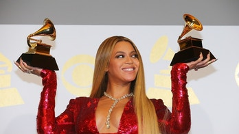 "Beyonce holds the awards she won for Best Urban Contemporary Album for ""Lemonade"" and Best Music Video for ""Formation"" at the 59th Annual Grammy Awards in Los Angeles, California, U.S. , February 12, 2017. REUTERS/Mike Blake - HP1ED2D0EDMWR"