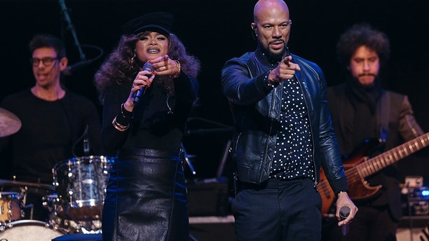 "Andra Day, left, and Common performs during the ""People's State of the Union"" event at The Town Hall in New York, Monday, Jan. 29, 2018."