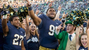 Sep 10, 2016; South Bend, IN, USA; Notre Dame Fighting Irish cornerback Julian Love (27) defensive lineman Jerry Tillery (99) and the Notre Dame leprechaun celebrate after Notre Dame defeated the Nevada Wolf Pack 39-10 at Notre Dame Stadium. Mandatory Credit: Matt Cashore-USA TODAY Sports - 9532533