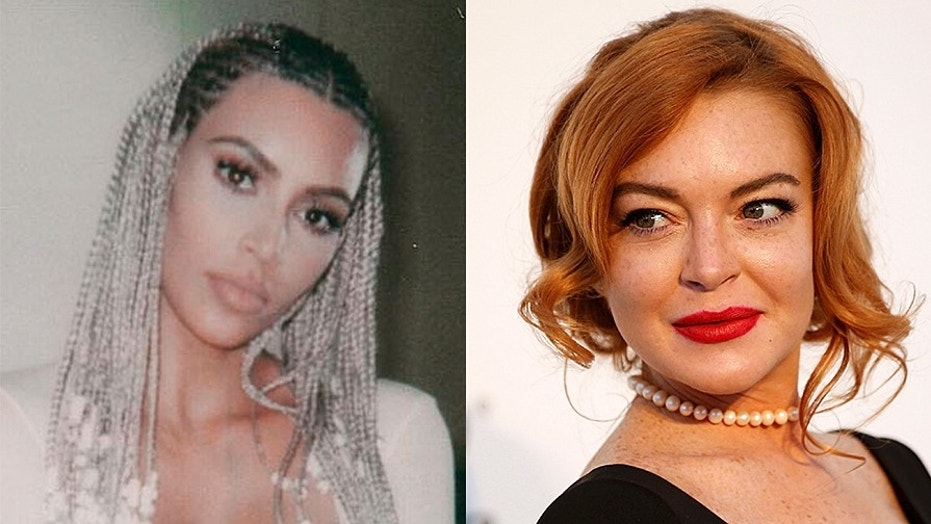 Kim Kardashian hit back at Lindsay Lohan after the actress criticized her blonde cornrows.