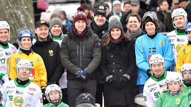 Britain's Catherine, Duchess of Cambridge and Prince William, Duke of Cambridge pose together with youth from the Hammarby bandy sports club, in Stockholm, Sweden January 30, 2018. Jonas Ekstromer/TT NEWS AGENCY/via REUTERS    ATTENTION EDITORS - THIS IMAGE WAS PROVIDED BY A THIRD PARTY. SWEDEN OUT. NO COMMERCIAL OR EDITORIAL SALES IN SWEDEN. - RC19015F3FB0