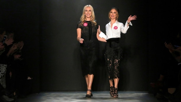 Fashion designers Keren Craig and Georgina Chapman acknowledge attendees after presenting the Marchesa Autumn/Winter 2017 collection during New York Fashion Week in Manhattan, New York, U.S., February 15, 2017.  REUTERS/Andrew Kelly - RC1C39997600
