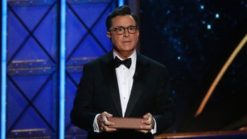 69th Primetime Emmy Awards – Show – Los Angeles, California, U.S., 17/09/2017 - Host Stephen Colbert holds a book as he speaks during the show. REUTERS/Mario Anzuoni - HP1ED9I05E164