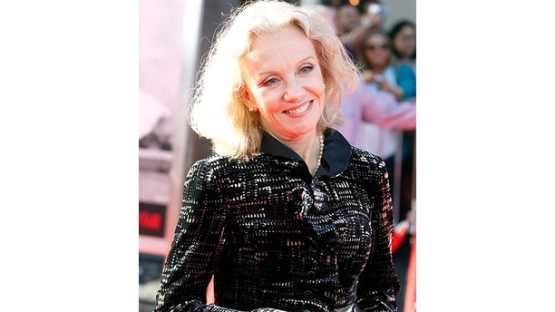 British actress Hayley Mills arrives at the opening night gala of the 2011 TCM Classic Film Festival featuring a screening of a restoration of 'An American In Paris' in Hollywood, California April 28, 2011.  REUTERS/Fred Prouser  (UNITED STATES - Tags: ENTERTAINMENT) - GM1E74T0Z7D01